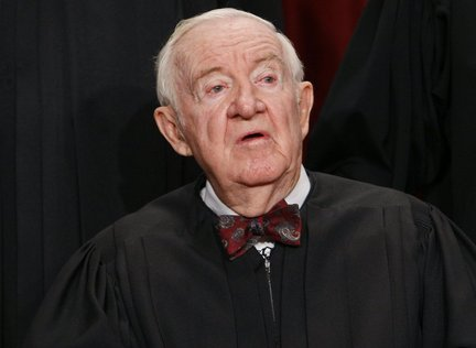 Justice Stevens sits for a group photograph, Tuesday, Sept. 29, 2009, at the Supreme Court in Washington. (AP Photo/Charles Dharapak)